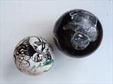 Traces of the story by Sara Muzira, Sculpture, Painting on found shot put balls